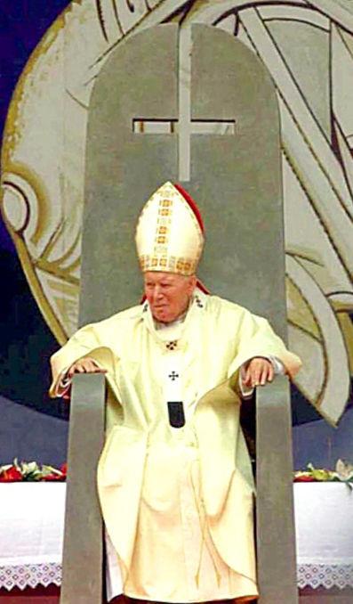 El Anticristo Juan Pablo II en Israel sentado en una silla con una cruz invertida sobre su cabeza, el 24 de marzo de 2000.